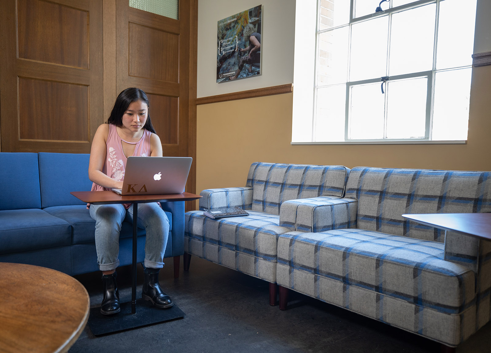 Student sitting in lounge using laptop to study